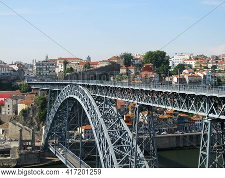 A Bridge Of Steel Across The River In Porto, Portugal.