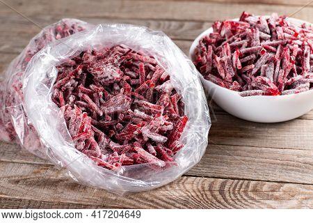 Frozen Beet In Plastic Bag On A Wooden Table. Frozen Food, Frozen Vegetables.