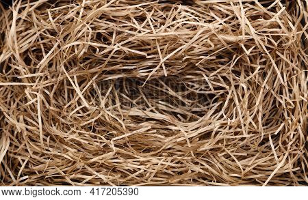 Shredded brown paper packaging close-up