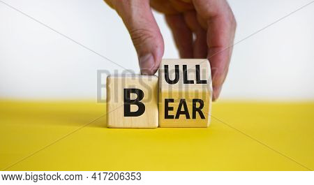 Symbol For A Positive Trend At The Stock Market. Businessman Hand Turns A Cube And Changes The Word