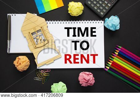 Time To Rent Real Estate Symbol. White Note, Words 'time To Rent' On Beautiful Black Background, Met