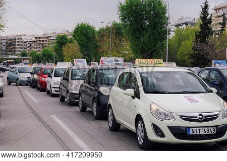 Thessaloniki, Greece - April 16 2021: Driving School Vehicles Marching On A Central City Road. Stopp