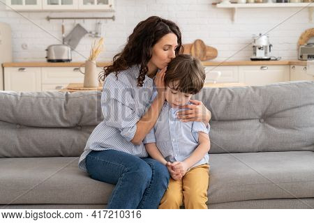 Mom Calm Frustrated Preschool Boy Embracing And Soothing. Young Mother Care For Upset Little Son. Lo