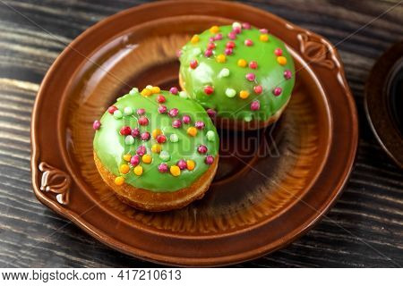 Bun, Donut Covered With Glaze. Tutti Frutti Bun On A Plate. Sweet Pastries. Dessert. View From Above