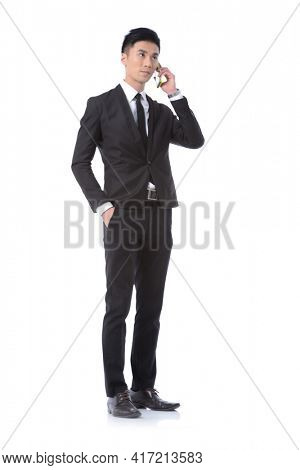 Full body Man business black suit ,tie with black pants ,shoes uses a, mobile ,phone,posing in studio