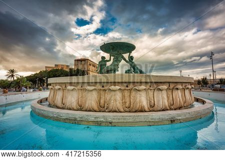 Valletta, Malta - January 11, 2019: Iconic Triton fountain in front of the City Gate to Valletta, capital of Malta