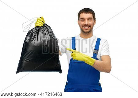 profession, cleaning service and people concept - happy smiling male worker or cleaner in overall and gloves showing garbage bag over white background
