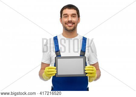 profession, cleaning service and people concept - happy smiling male worker or cleaner in overall and gloves showing tablet pc computer over white background