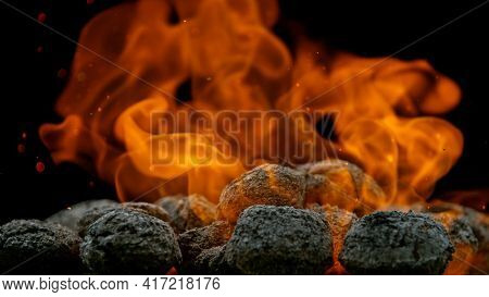 Charcoal briquettes ready for barbecue grill.