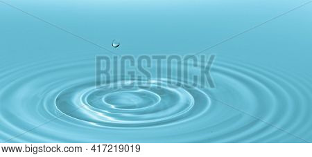 Waves on the surface of the water from a collision. Drop of water drop to the surface.