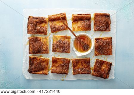 Sopapilla Cheesecake Bars With Cinnamon Drizzled With Honey