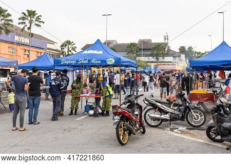 Kuala Lumpur, Malaysia, April 16, 2021: Temperature Check And Contact Tracing Enforced At Street Baz