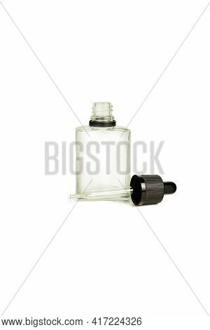 A Bottle With A Pipette, Isolated On A White Background. Glass Container For Cosmetic Skin Care Prod