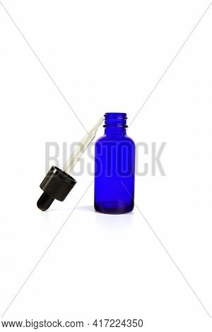 Blue Glass Bottles.a Bottle With A Pipette, Isolated On A White Background. Glass Container For Cosm