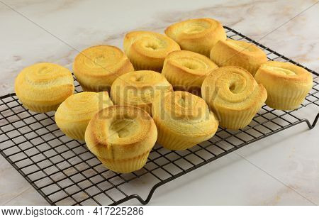 Swirl Corn Muffins Fresh Out Of The Oven On Cooling Rack