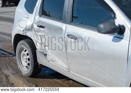 Car After An Accident With Damage To The Body, Outside. Dents And Scratches On The Rear Door And Fen