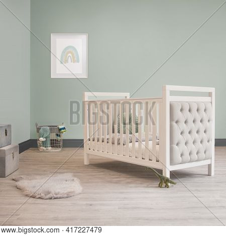Blue And Grey Baby Bedroom Nursery Kids Room. Cot And Bed Interiors With Rainbow Picture And Faux Fu
