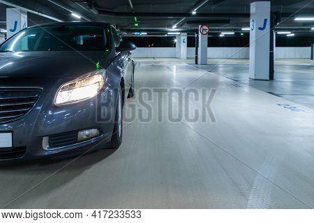 Rent Parking Space. Car Lot Parking Space In Underground City Garage. Empty Road Asphalt Background.