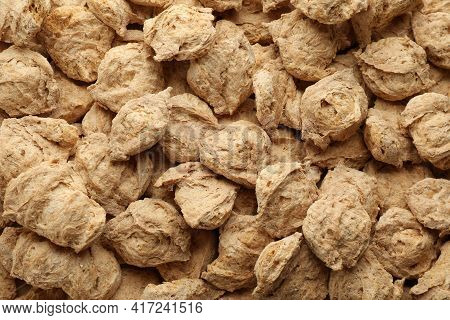 Dehydrated Soy Meat Chunks As Background, Top View