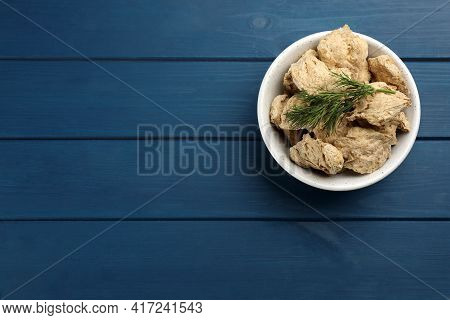 Dehydrated Soy Meat Chunks With Dill In Bowl On Blue Wooden Table, Top View. Space For Text