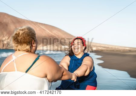 Happy Plus Size Women Having Fun On Tropical Beach During Summer Vacation - Overweight Confident Peo