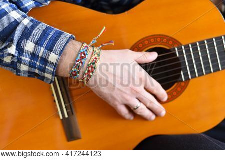 Friendship Bracelets With Indian Pattern On The Guitarist's Wrist