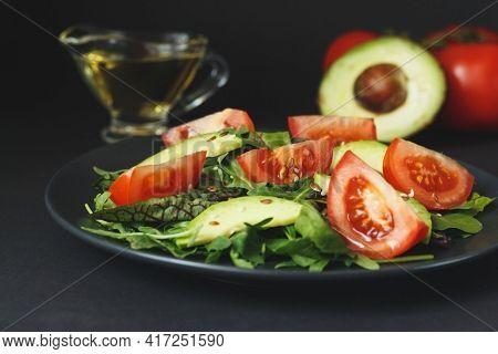 Healthy Salad Of Fresh Vegetables - Tomatoes, Avocado, Arugula, Seeds