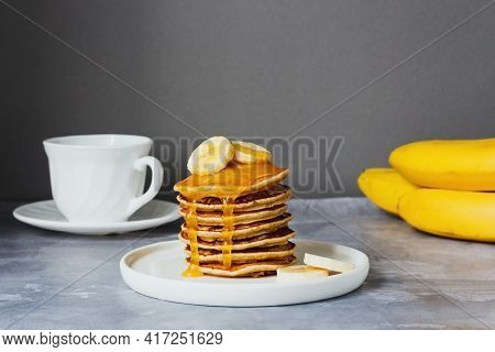 Sweet Homemade Stack Of Pancakes With Banana And Honey. Delicious Breakfast.