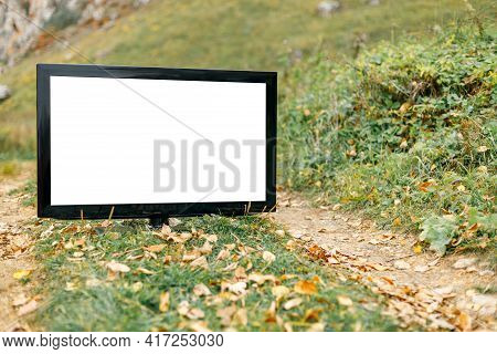 Mocap From The Tv Screen For The Inscription, The Tv Is Located On A Dirt Road In The Autumn