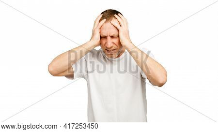 The Man Grabbed His Head With His Hands. Problems, Stress, Headache Concept.