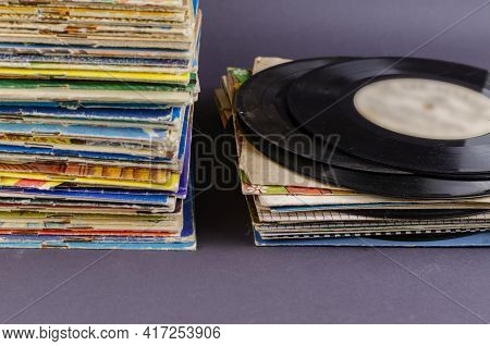 A Collection Of Old Comics, Magazines, And Vinyl Records On A Gray Background. Lots Of Old Shabby Pr