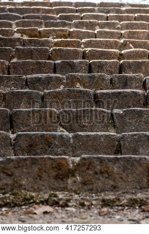 Vertical Photo Of Old Brick Stone Stairs. Ancient Stone Stairs Going Up To The Sunlight. Brown Histo