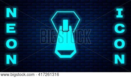 Glowing Neon Zipper Icon Isolated On Brick Wall Background. Vector