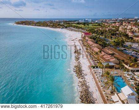 Aruba Caribbean White Beach With Palm Trees And Luxury Swimming Pool Aruba Caribbean Sea