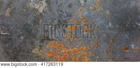 Rusty Black Painted Metal Wall. Rusty Metal Background With Streaks Of Rust. Rust Stains. The Metal