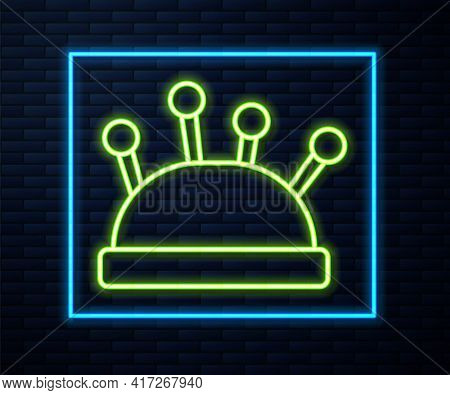 Glowing Neon Line Needle Bed And Needles Icon Isolated On Brick Wall Background. Handmade And Sewing