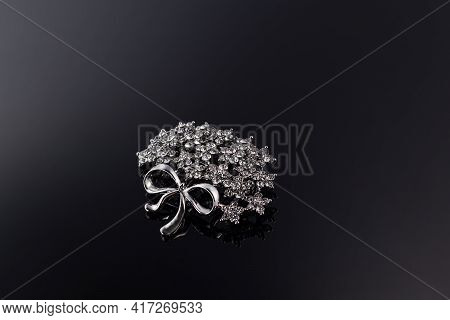 Bijouterie And Jewelry On A Dark Background. Brooches And Hairpins Earrings And Pendants. Copy Space