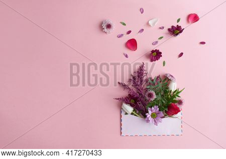 Assorted Flowers Falling Out Of An Envelope