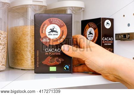 Tambov, Russian Federation - March 19, 2021 Woman Hand Taking Organic Bitter Cocoa Powder Pack By Al