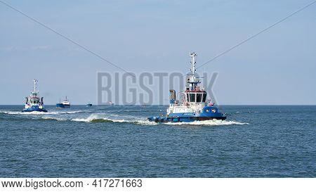 Swinoujscie, Poland - September 12, 2020: Tugboat Escorting A Ship On The Way To The Port Of Swinouj