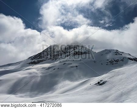 View Of The Cloud-covered Fanellhorn In The Canton Of Graubunden. Great Ski Tour Above Valles. Swiss