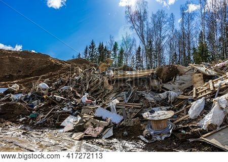 Landfill Of Construction Waste And Garbage In Nature. Environmental Pollution. Illegal Construction