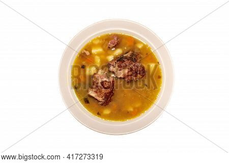 A Plate Of Pea Soup With Smoked Pork On A White Background Top View.pea Soup With Smoked Ribs.