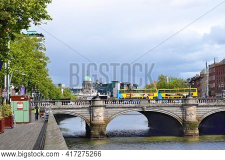 DUBLIN, IRELAND - MAY 12, 2011: O'Connell Bridge.  The bridge spans the River Liffey joining O'Connell Street to D'Olier Street, Westmoreland Street and the south quays.