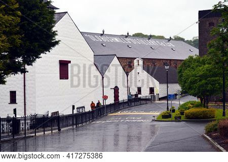 BUSHMILLS, NORTHERN IRELAND - 20 MAY 2011: The Old Bushmills Distillery has been in continuous operation since it was rebuilt after a fire in 1885.