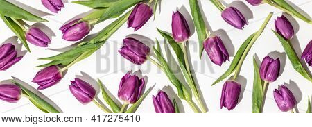 Pink tulips pattern on white background flat lay, top view. Valentine's background. Floral pattern. Pattern of flowers. Flowers pattern texture