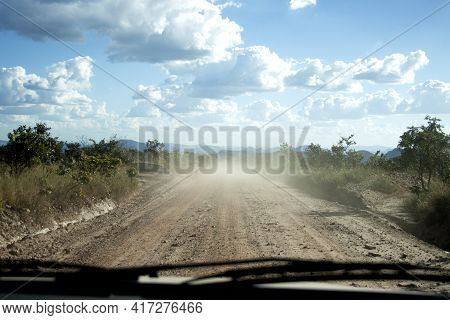 Driving On A Dirt Road To Deliver Parcels In Rural Areas Of Brazil. Distant Destinations. Dirt Road