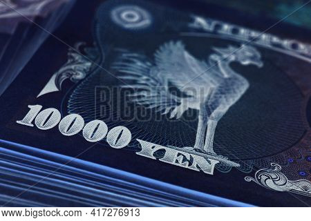 A Bundle Of 10,000 Yen Japanese Bills. Dark Ominous Illustration About Money, Banking And The Econom