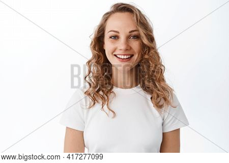 Smiling Blond Woman With White Perfect Smile And Natural Face, Looking Happy And Confident At Camera