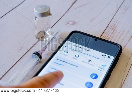 Man Doctor Pointing To Arogya Setu App Co-win While Getting Vaccinated With Covaxin Covishield With